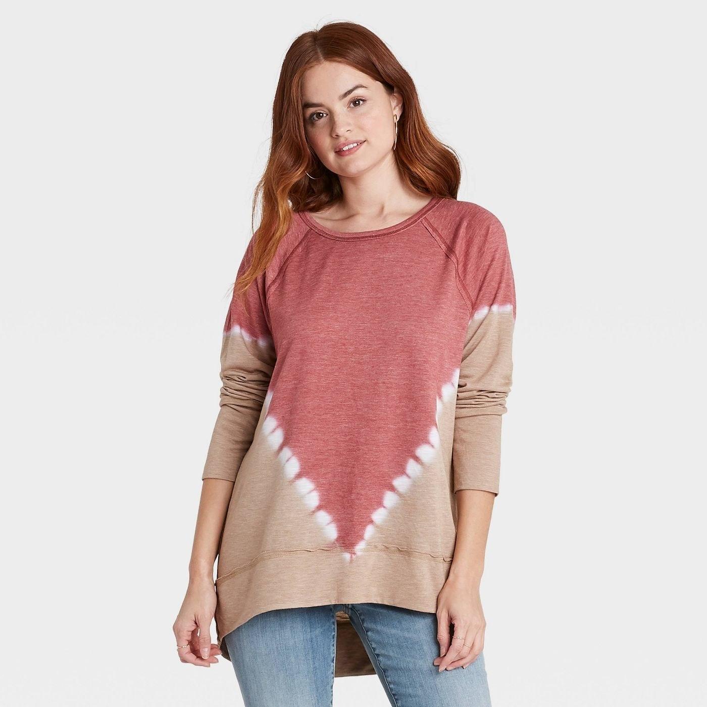 Model in tie-dye sweatshirt