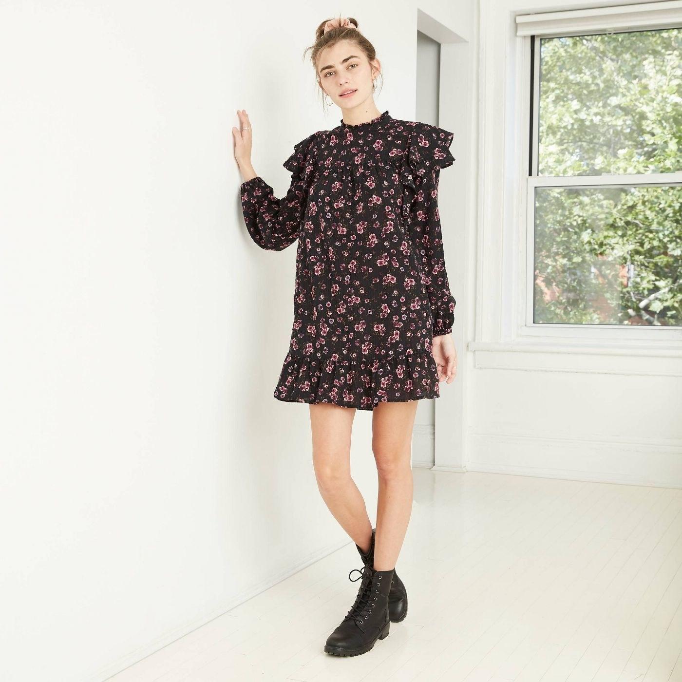 Model in long sleeve ruffle dress