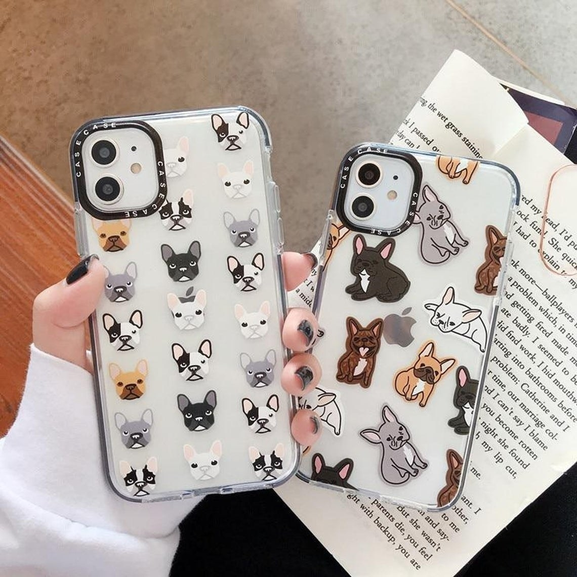 A person holding two Frenchie phone cases