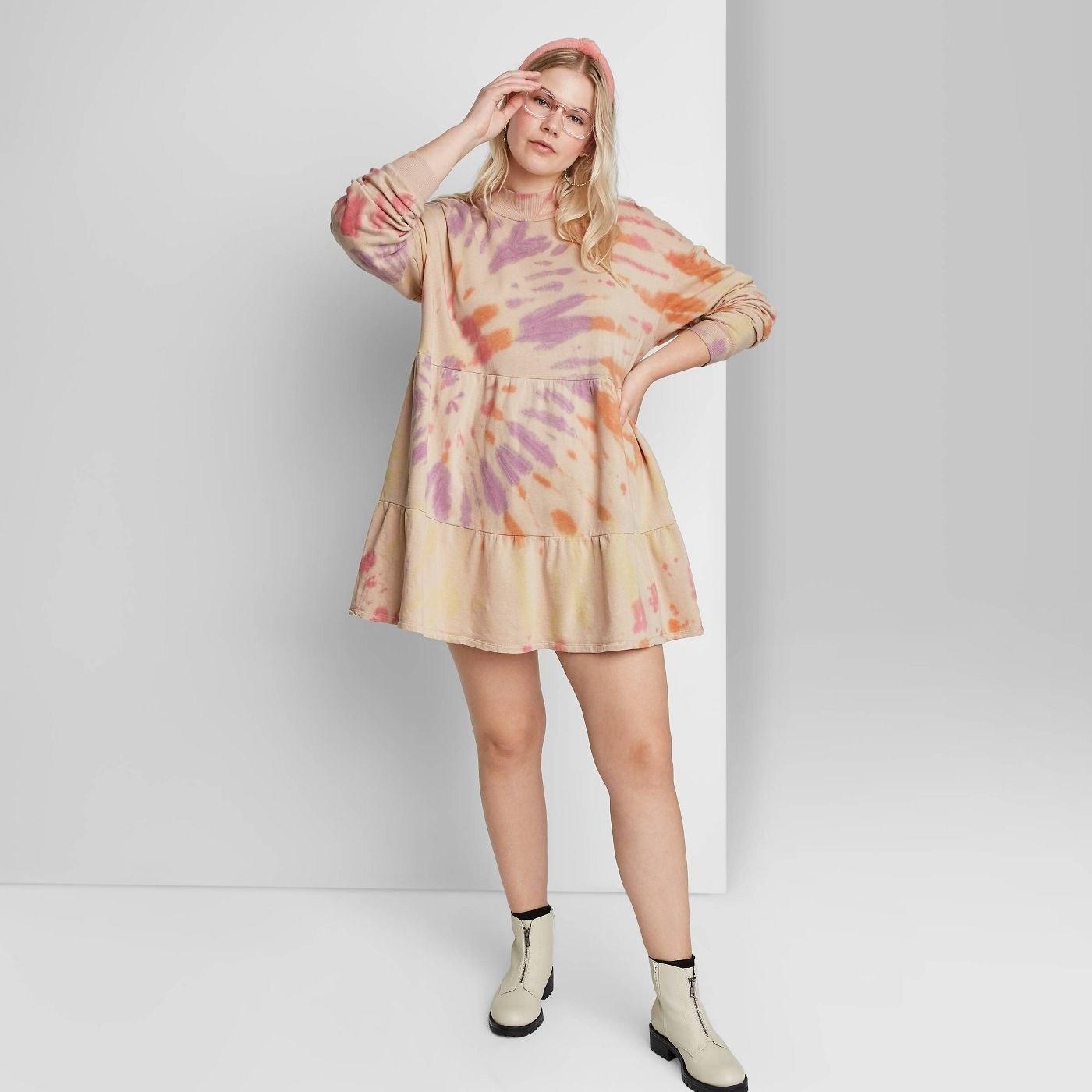 Model in long sleeve sweatshirt dress