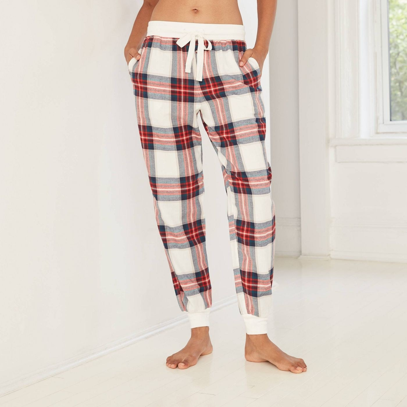 Model in cozy plaid flannel jogger pants