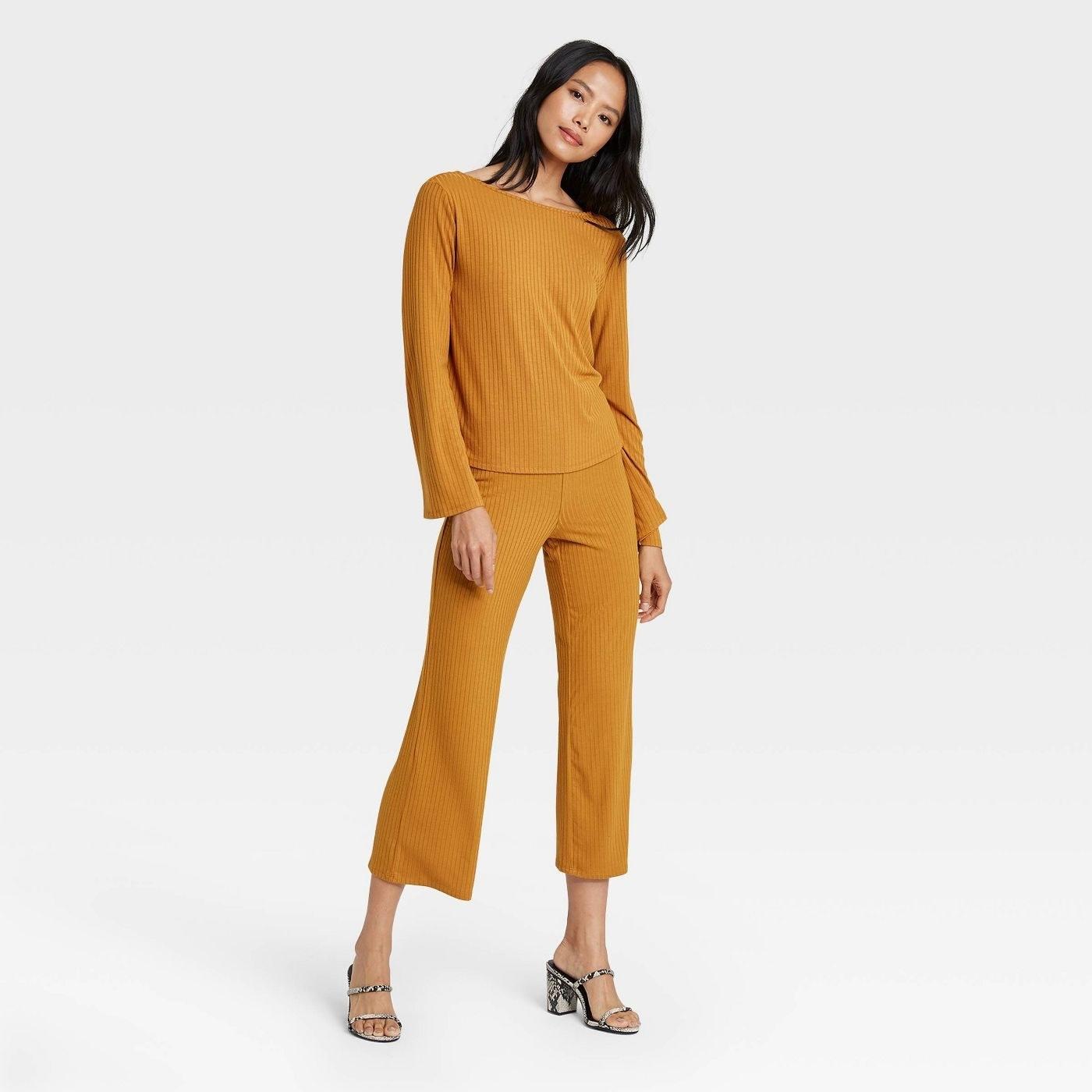 Model in long sleeve boat neck t-shirt