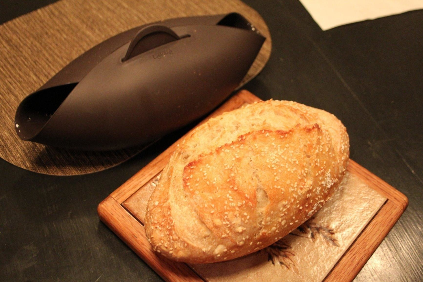 reviewer image of a loaf of bread next to the lekue silicone bread maker