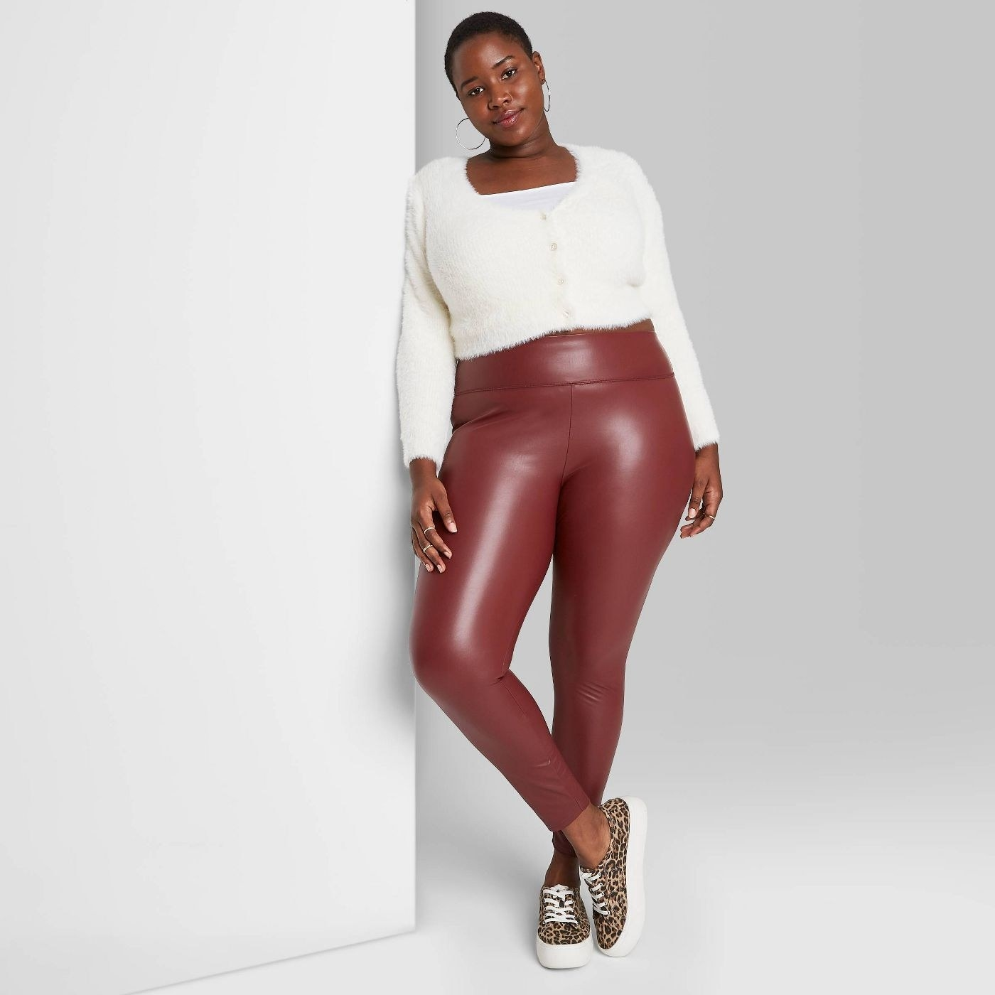 Model in high-waisted faux leather leggings