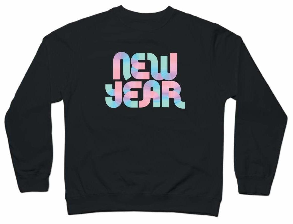 "Black crewneck sweatshirt with words ""New Year"" in multiple pastel colors"
