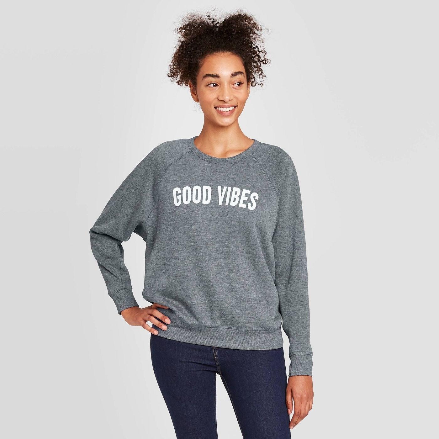 Model in good vibes graphic sweatshirt