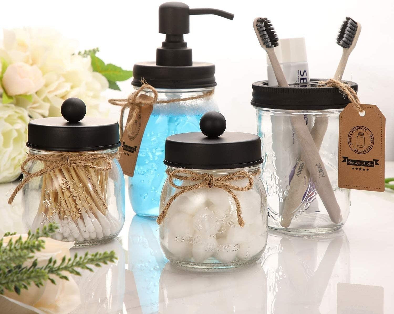 Four mason jars in use on counter