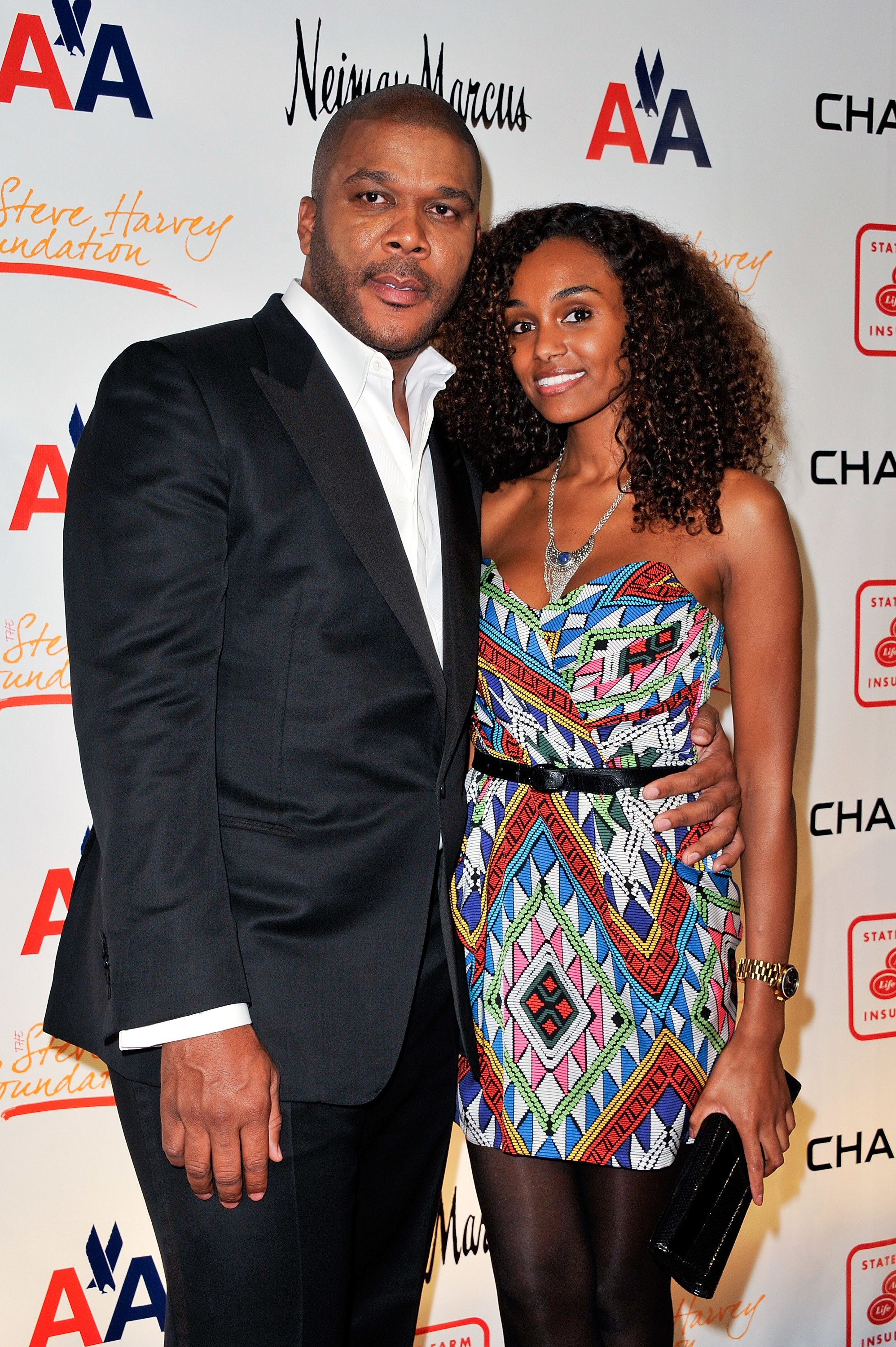 Director Tyler Perry (L) and model Gelila Bekele