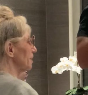 Drake's mom, Sandi Graham, watches peacefully