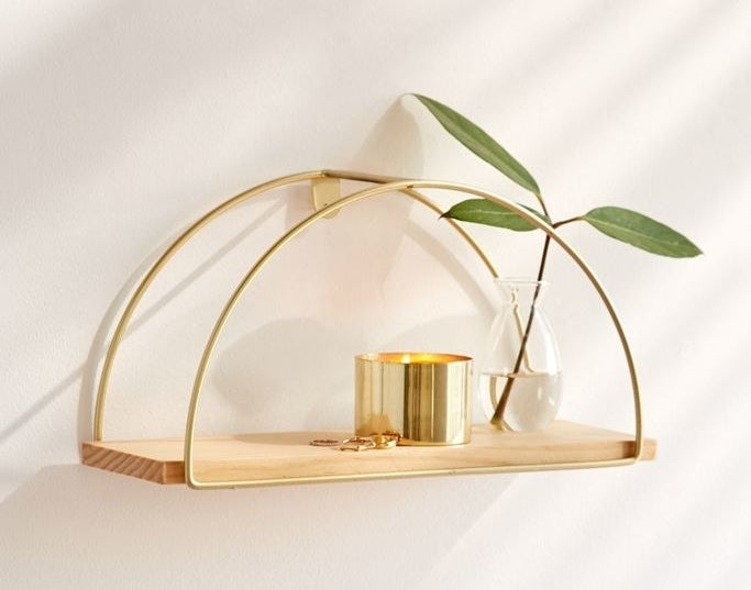 The gold half circle shelf