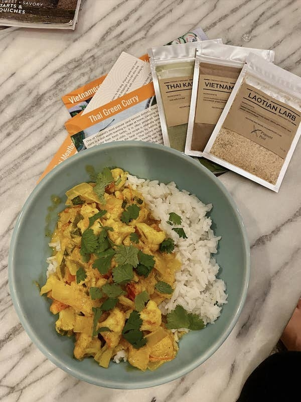 a plate of cauliflower curry and rice made by BuzzFeed Editor Kayla Suazo using the piquant post spices