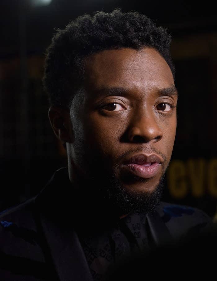 Chadwick Boseman looking at the camera