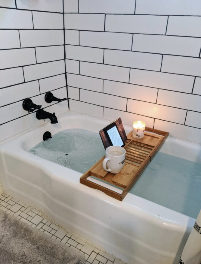 Reviewer using bath caddy over tub