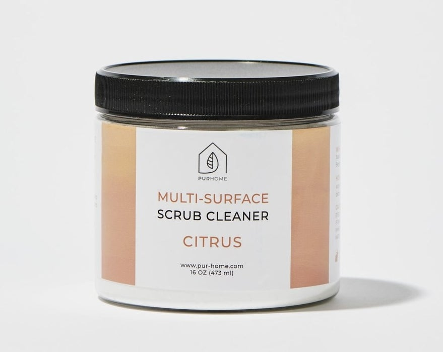 """Clear orange and white container that says """"Pardo Naturals Multi-Surface Scrub Cleaner"""""""