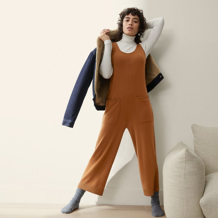 A model in the tank jumpsuit in light brown over a turtleneck