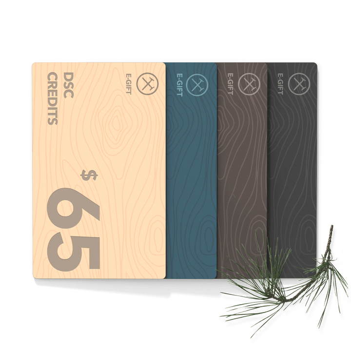 Four different colored Dollar Shave Club gift cards