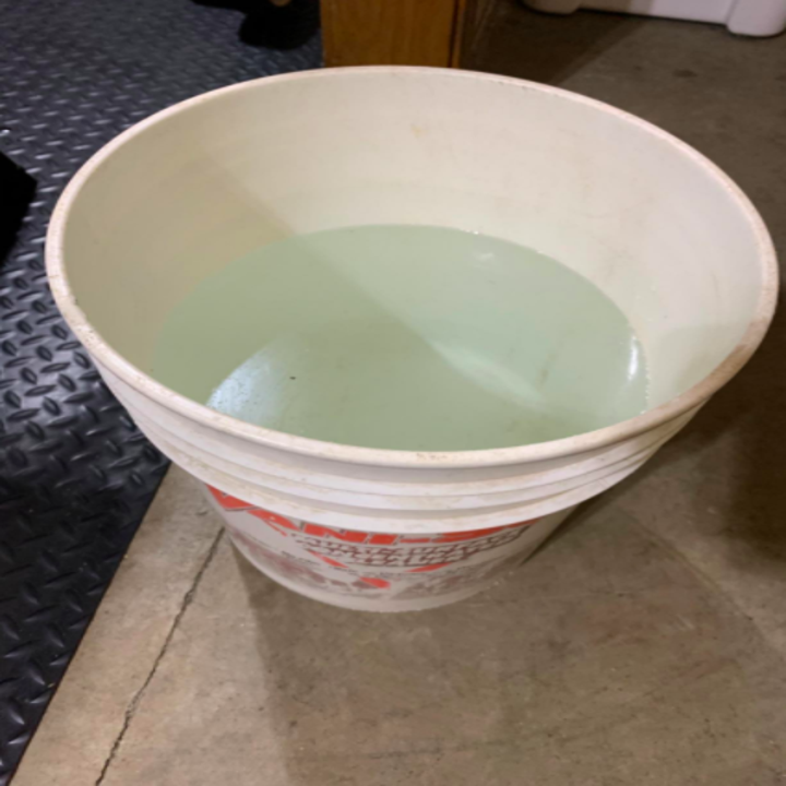 a reviewer's photo of a bucket of water extracted from the dehumidifier