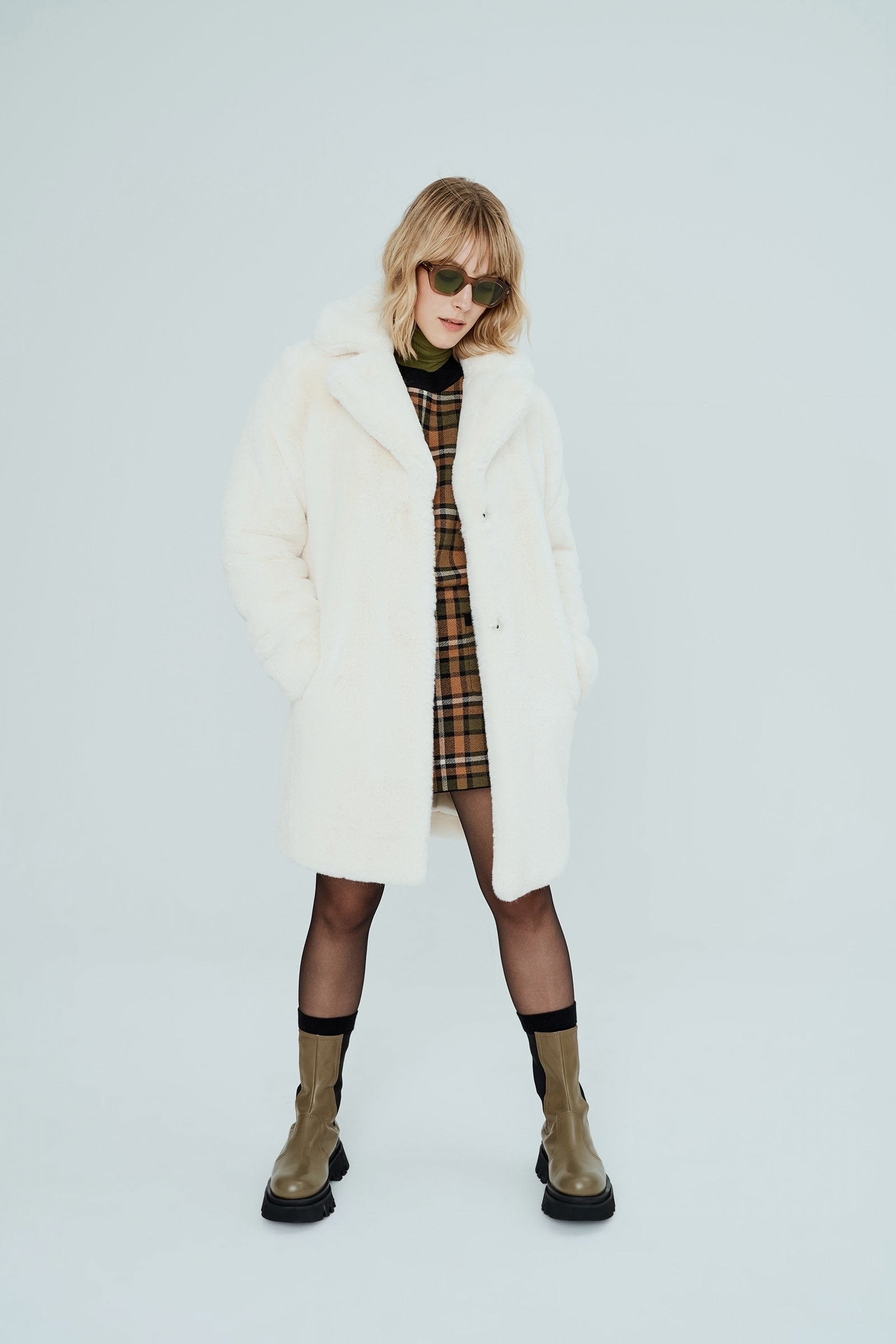 A model in the coat in ivory
