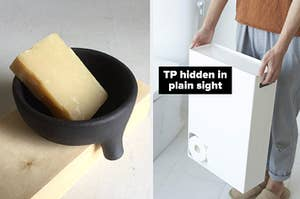 on left a black soap dish and on right a toilet paper holder