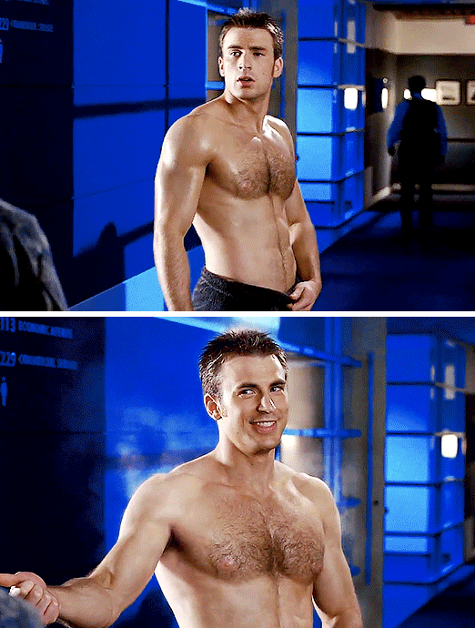 Johnny Storm walking around without his shirt on, smiling handsomely