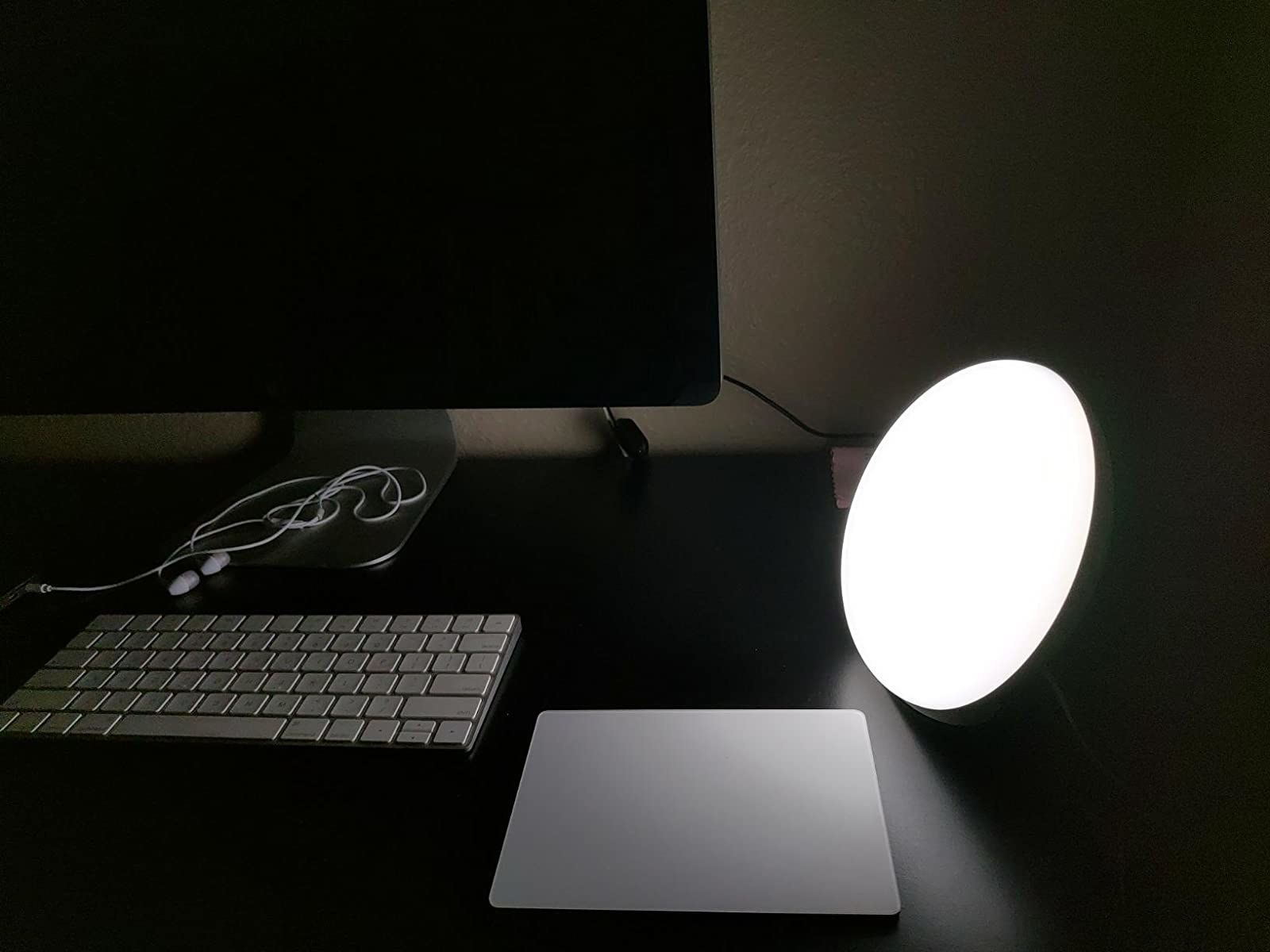 reviewer photo showing the therapy light on their desk next to their computer