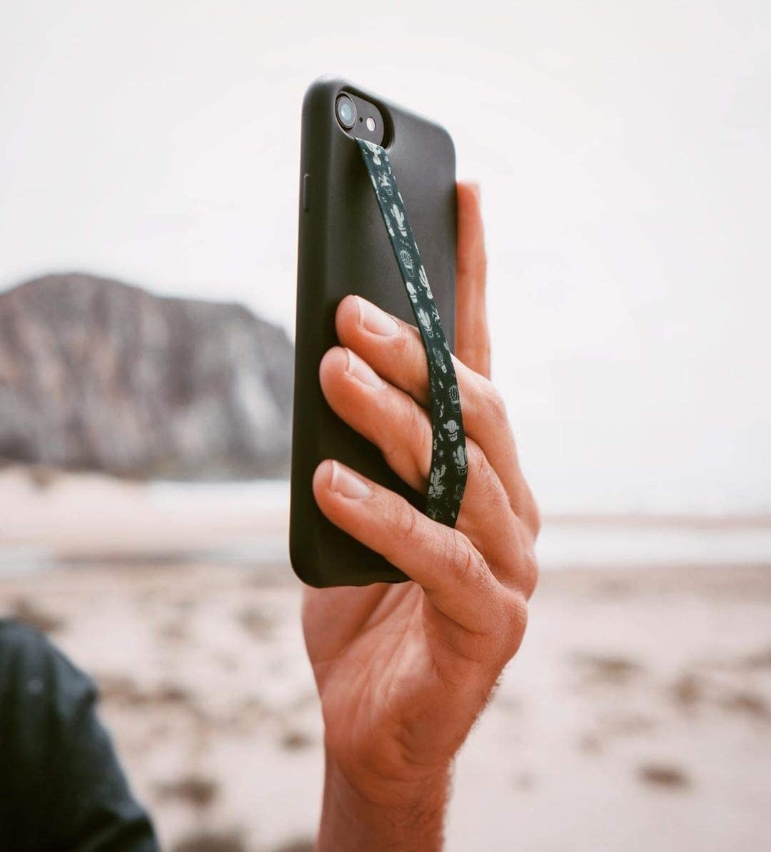 A person using the grip to hold their phone