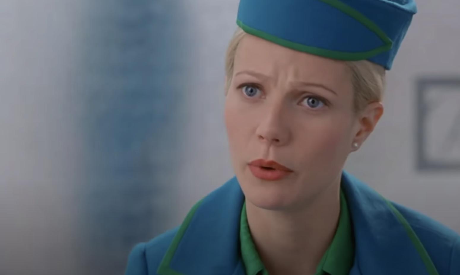 Donna sitting in her flight attendant uniform