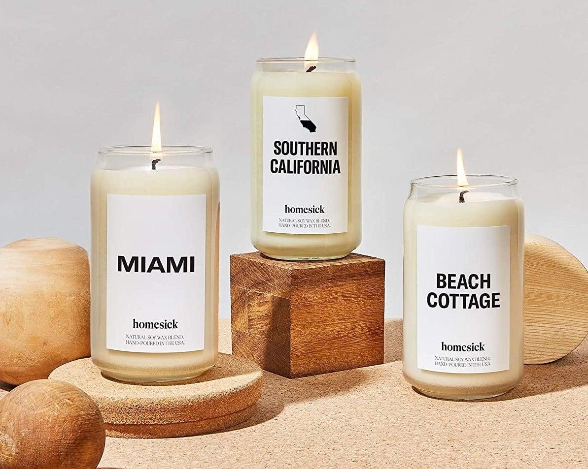 Homesick candles on rocks and sand