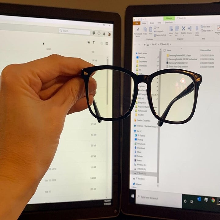 Reviewer wearing blue light blocking glasses