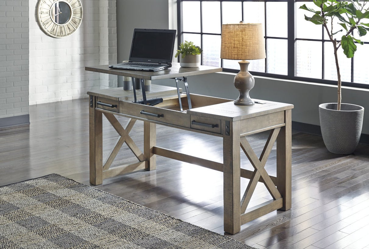 wooden desk with the lift-top up to create a standing desk