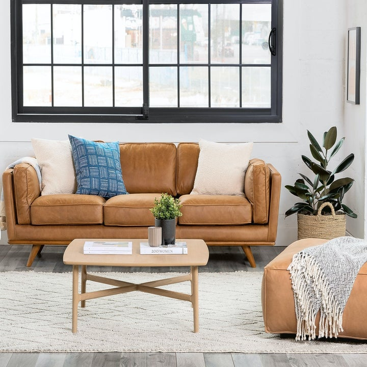 The mid-century modern couch in tan