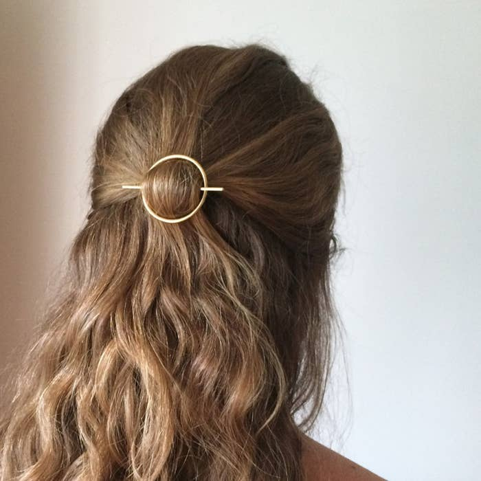 back of persons head with the round clip
