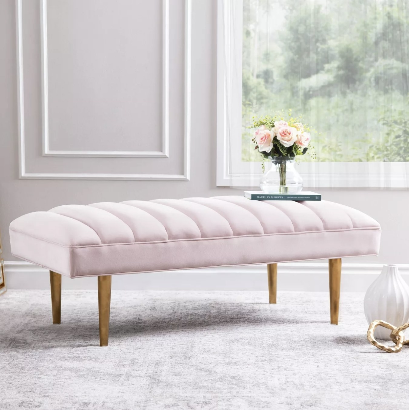 A blush tufted bench