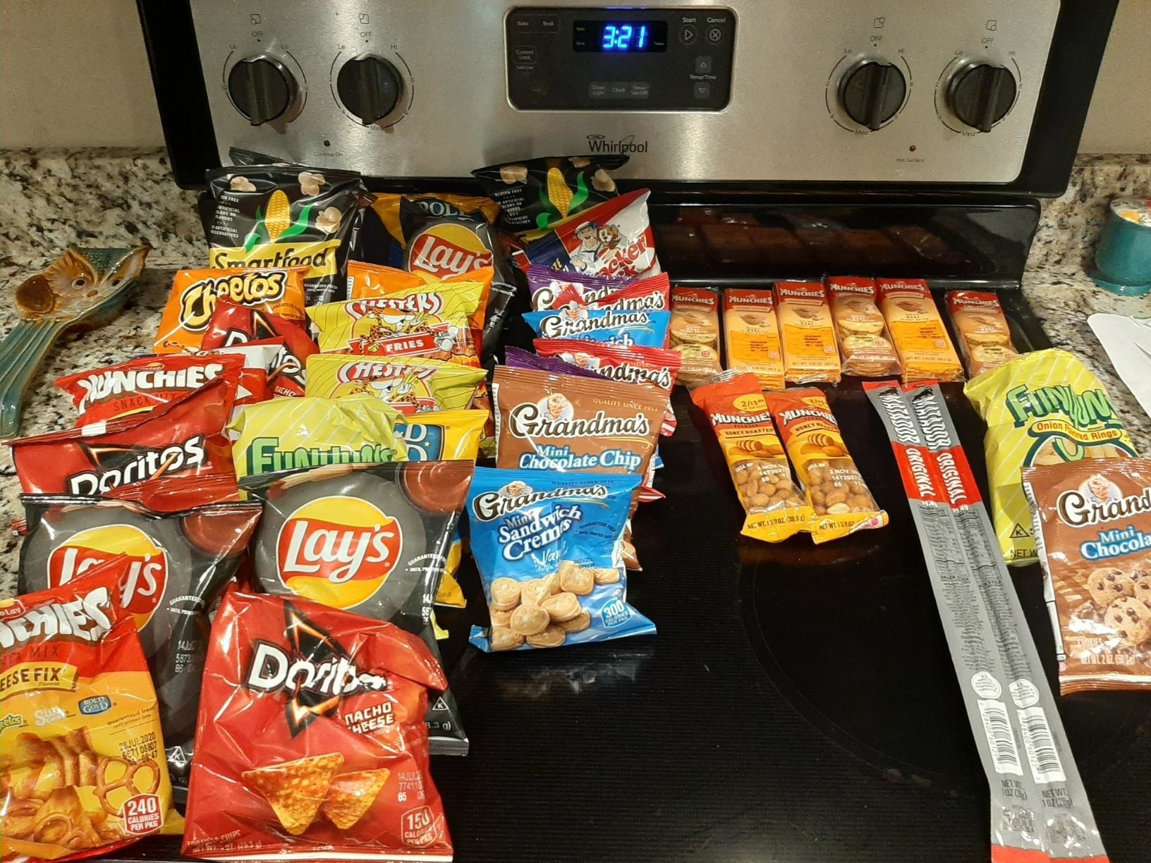 Reviewer snack assortment laid out on stove