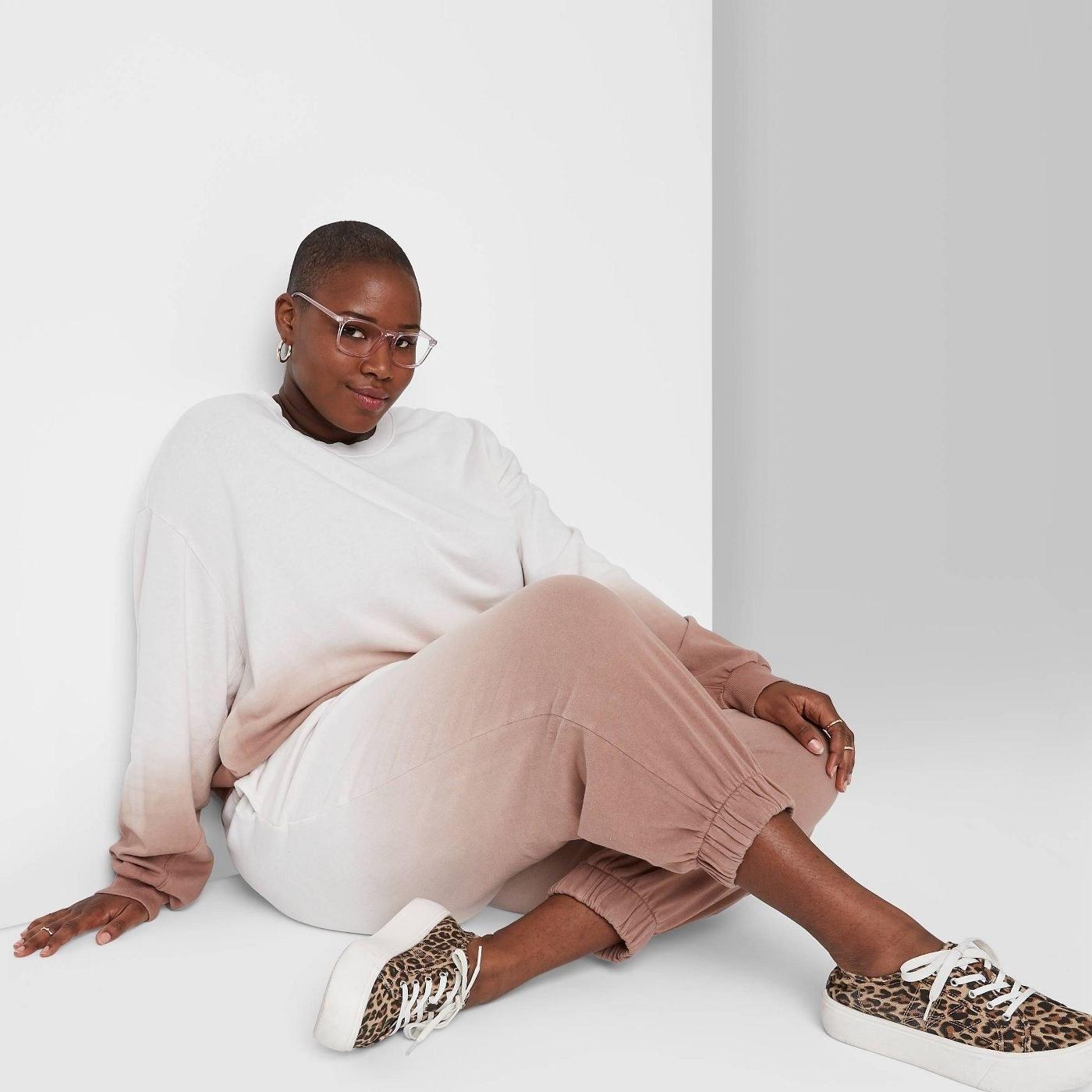 Model in high rise vintage sweatpants in tie dye