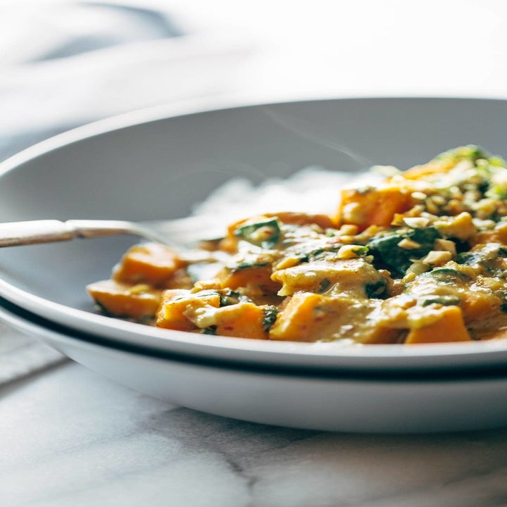 A bowl of sweet potato curry with rice.