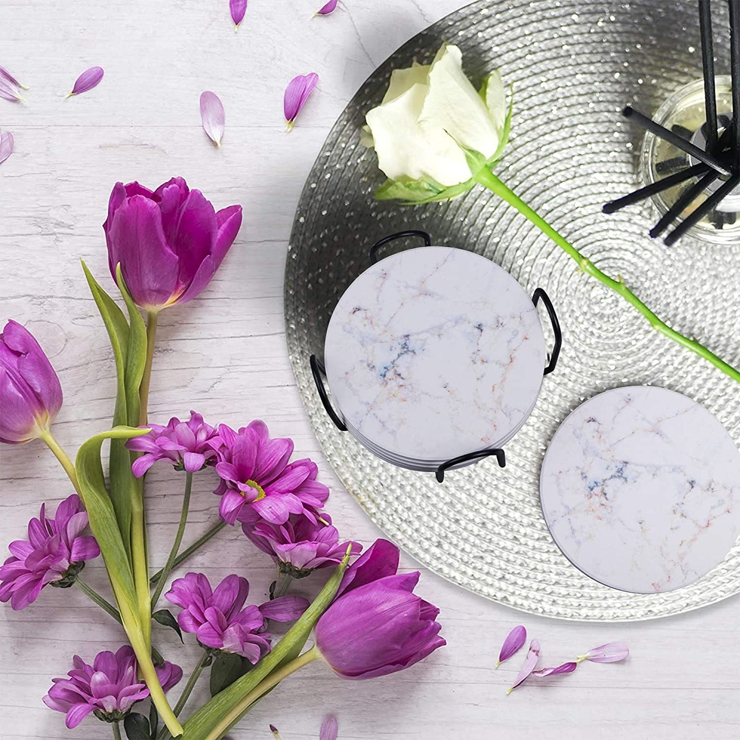 tabletop with flowers and the marbelized looking stone coasters