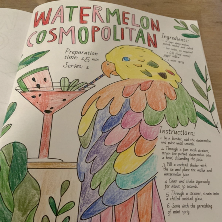 reviewer photo of a colored page with a bird sipping a watermelon cosmopolitan with a provided recipe
