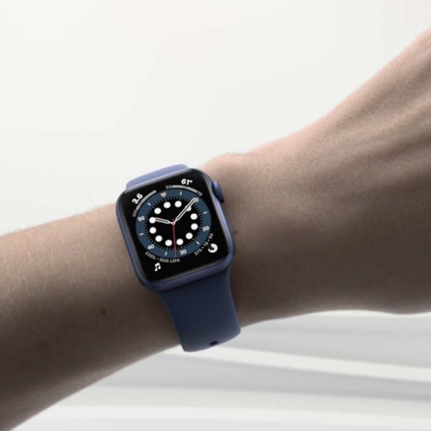 Person is wearing a blue Apple watch