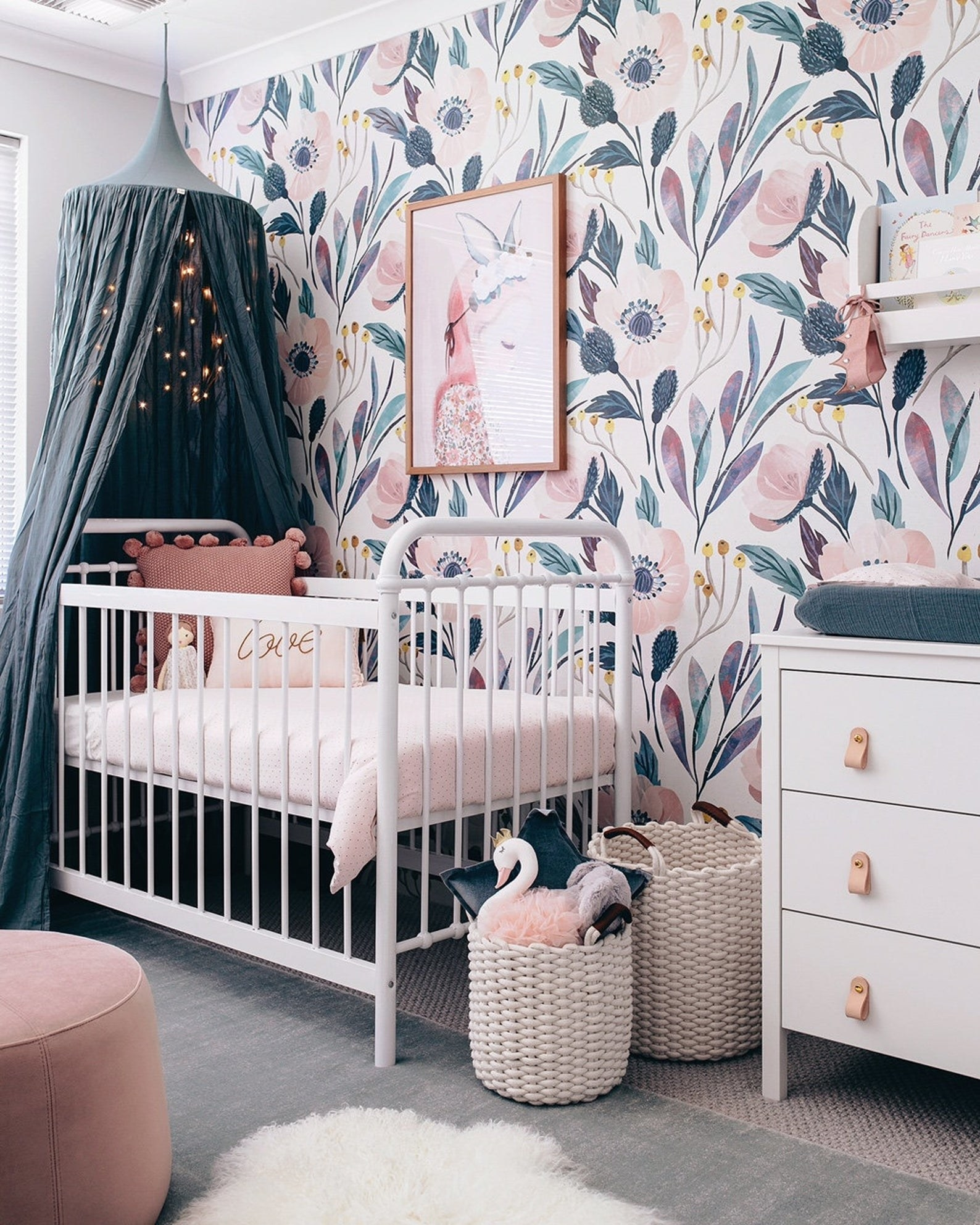 a bedroom with the floral wallpaper