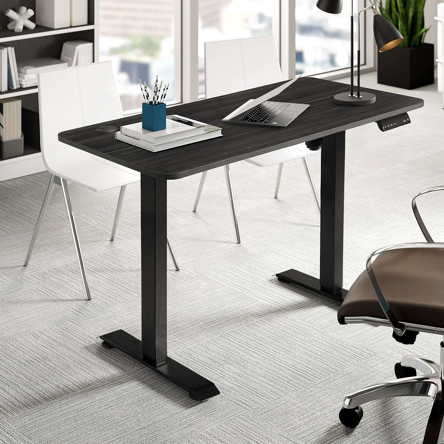 the desk in the color black with office supplies and a computer on it