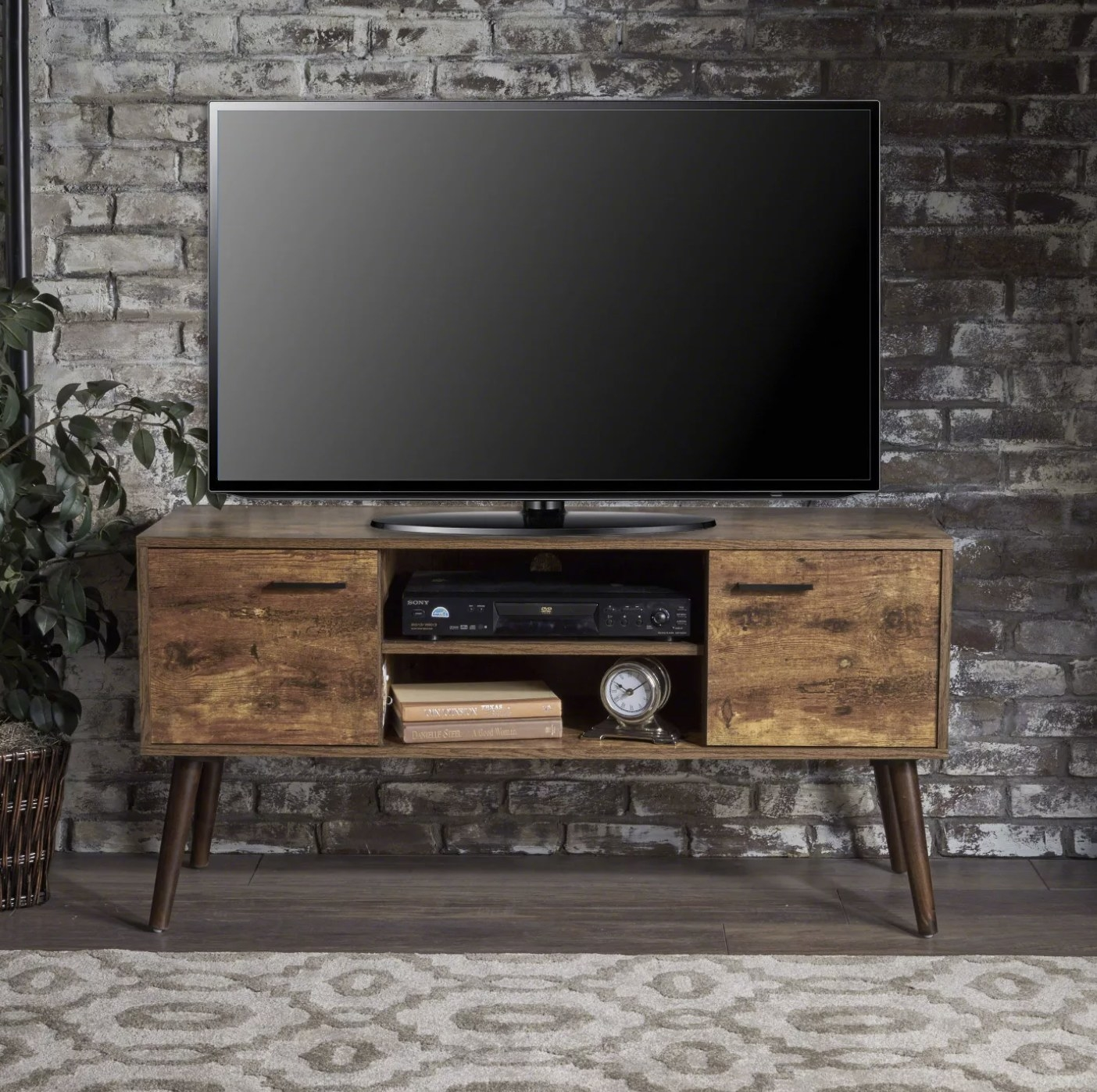 An entertainment stand with a TV on top