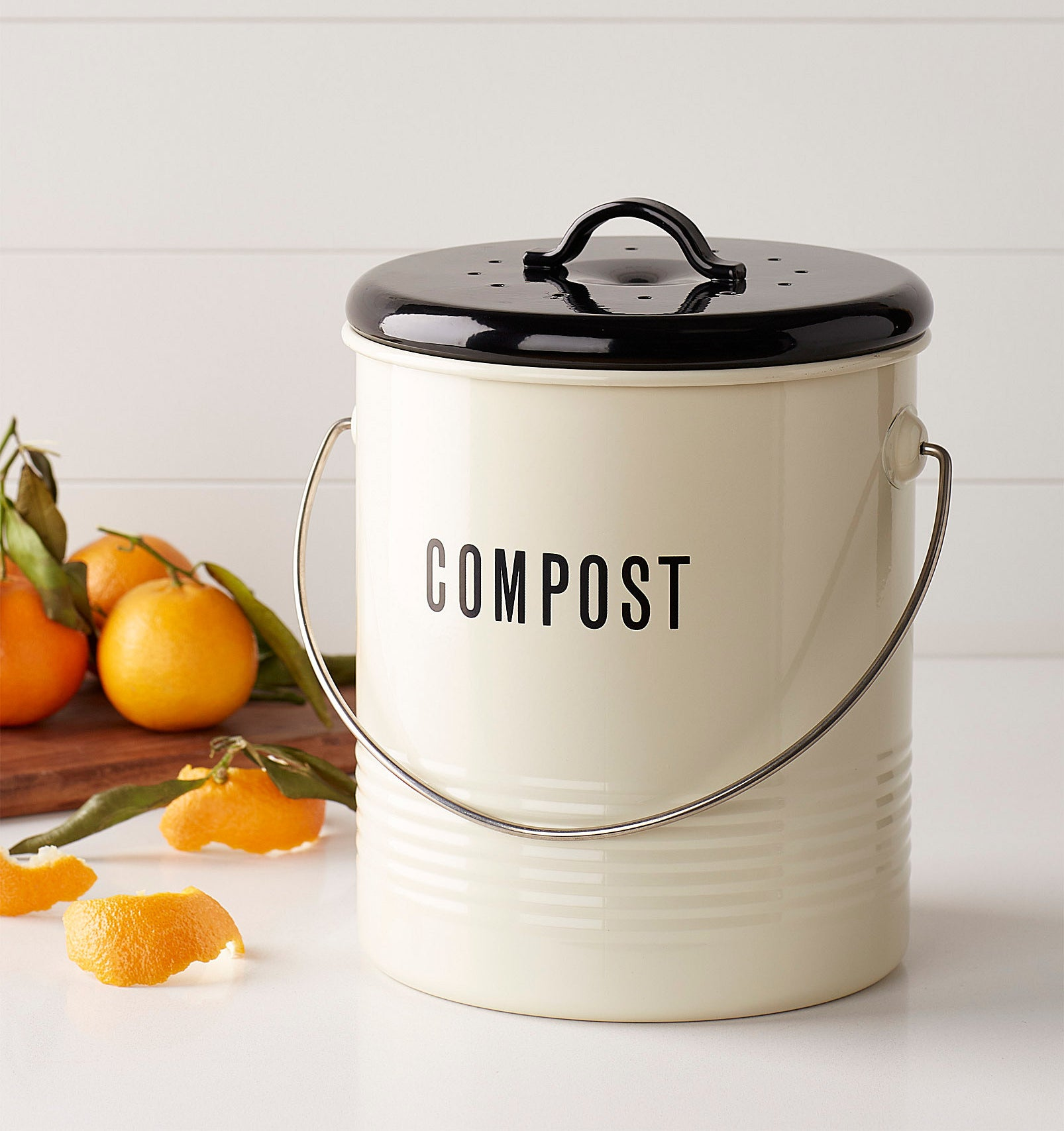 """A cute compost bin that says """"compost"""" on it"""