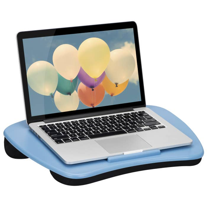the lap desk in blue with a computer on it
