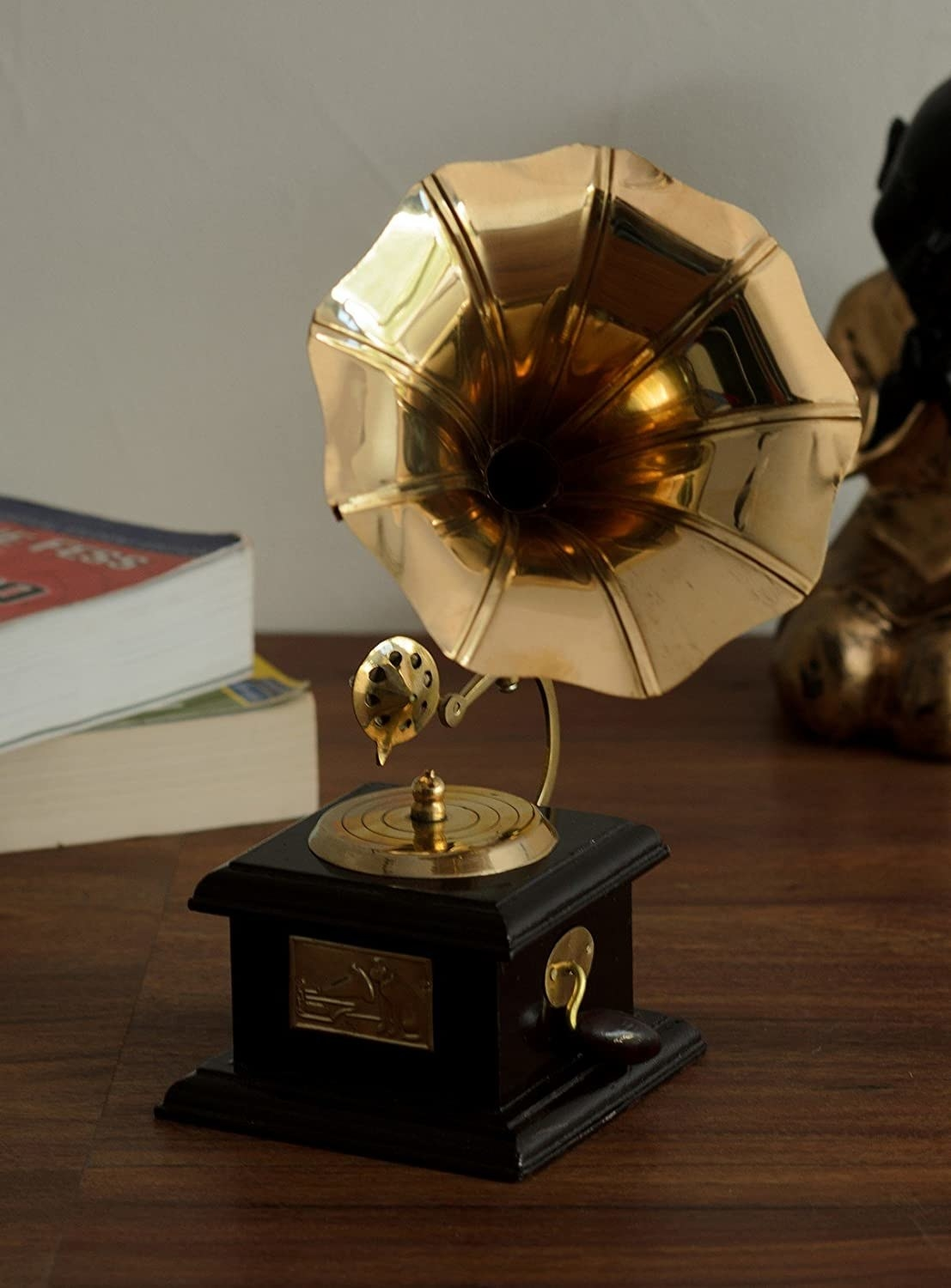 A brass gramophone on a table