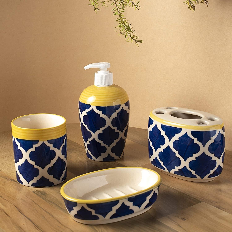 A blue and white ceramic bathroom accessories set