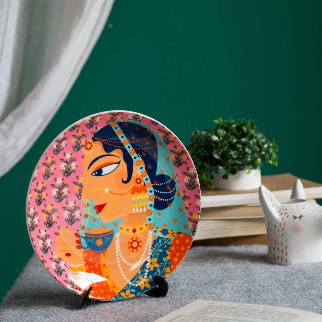 A colourful wall plate with a princess on it