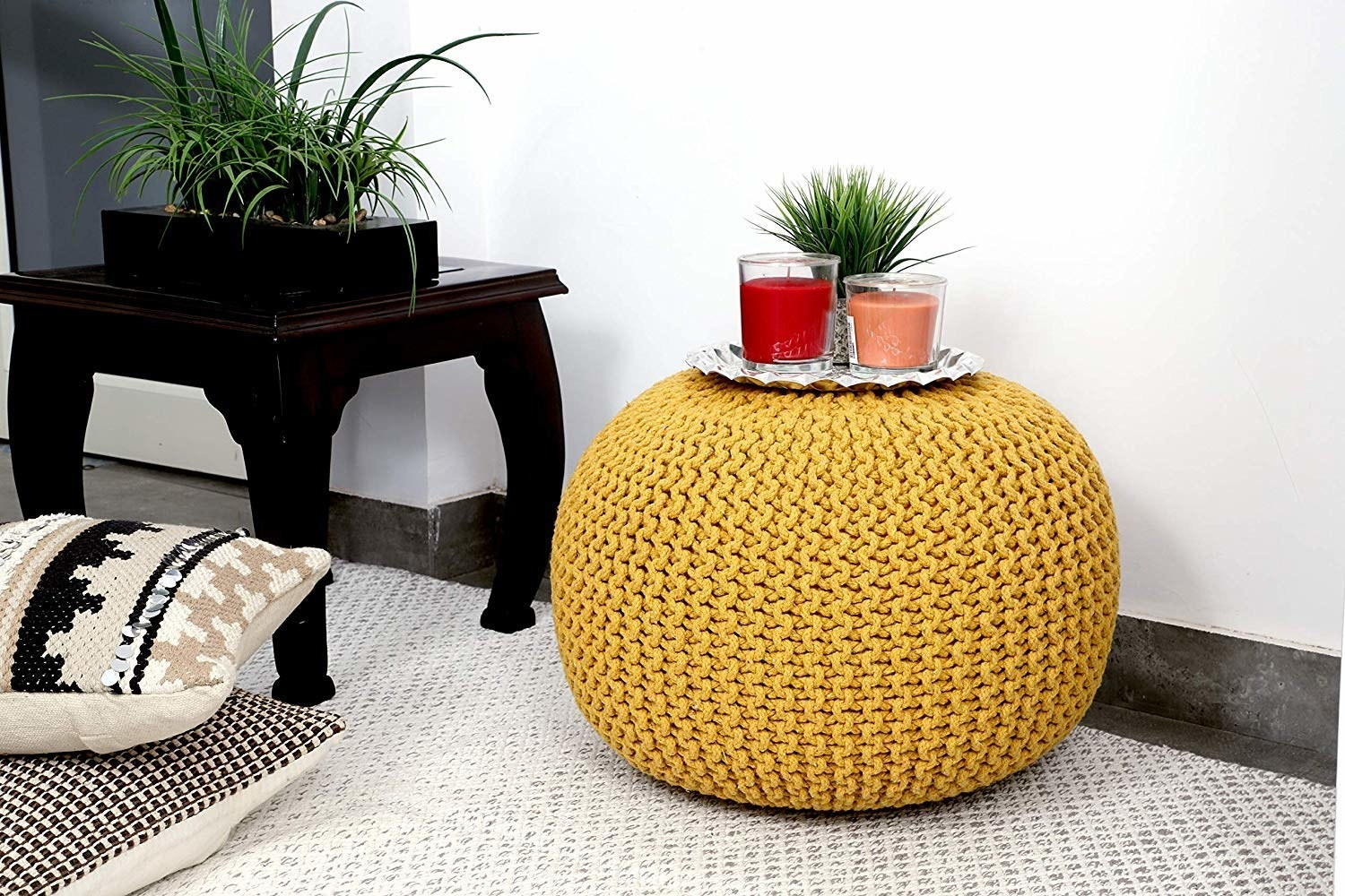Yellow pouffe with items on it
