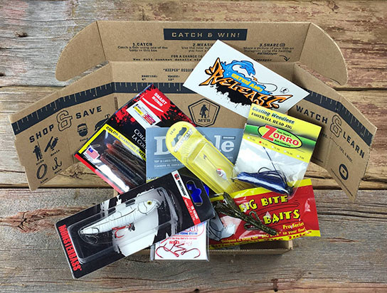 the mystery tackle box opened showing the different baits, lures and tackles