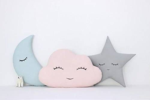 A moon, a cloud, and a star-shaped cushion